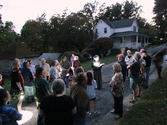 "Eileen, as former caretaker Martha McGaha, welcoming and leading guests through their tour of ""haunted"" cemetery grounds"